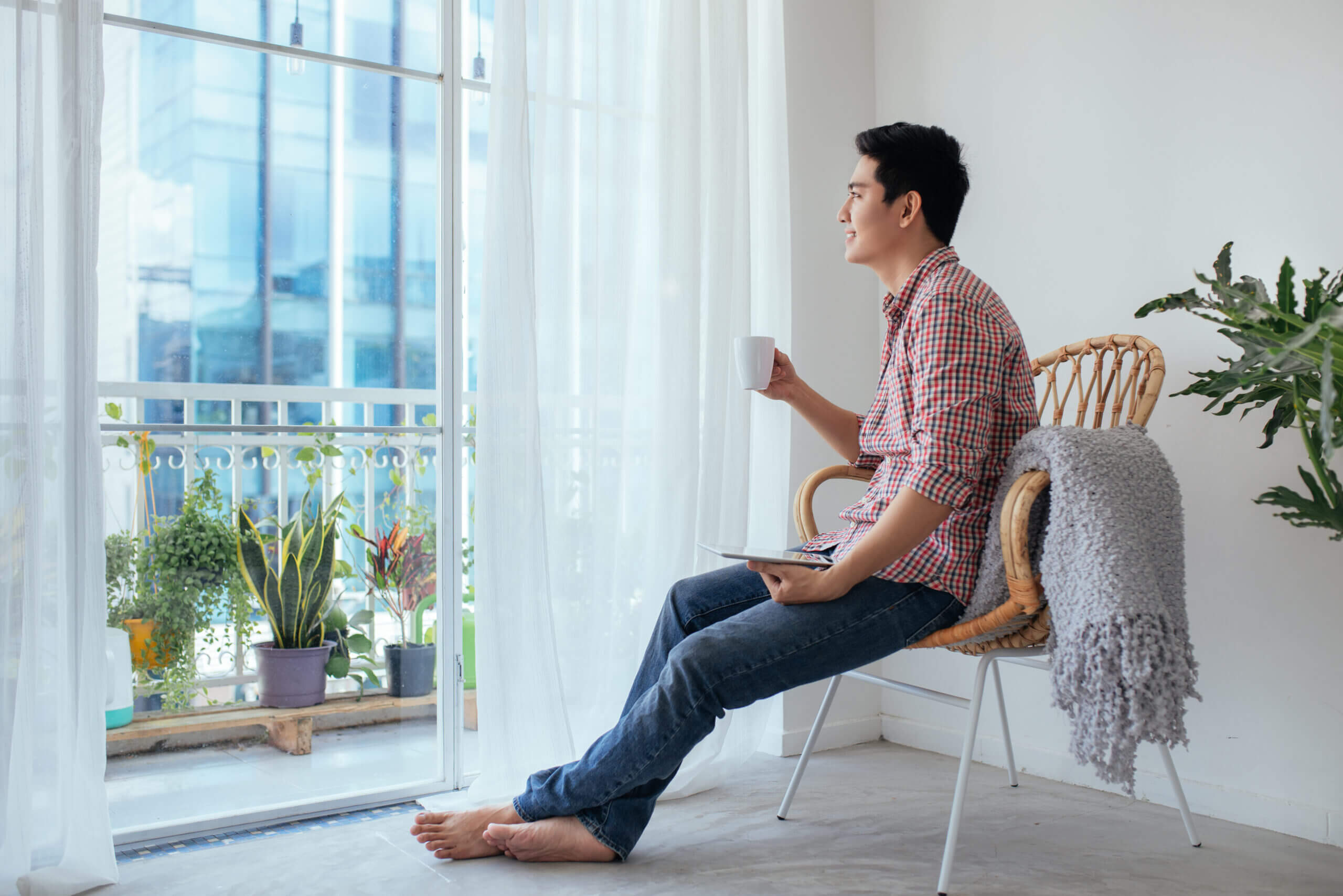 Man relaxing with coffee at home